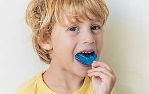 Young child with blue mouthguard