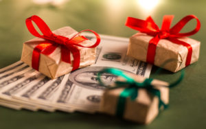 stack of money with small gifts