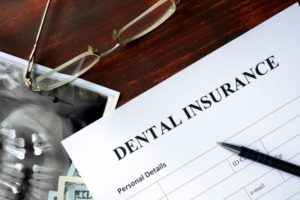 dental insurance form on dark wooden table