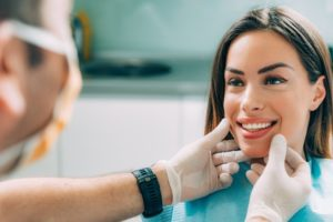 Dentist checking patient for oral cancer